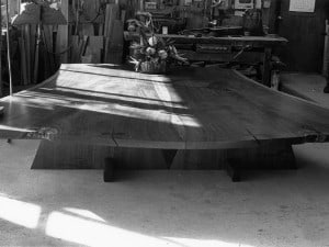 """In the Nakashima workshop before sending the Sacred Peace Table to India, Miriam Belov read from Sri Aurobindo's epic poem """"Savitri"""" and led a meditation. Gary Boxer sang an original composition """"A Mighty Soul"""" with guitar. Two priests consecrated the Sacred Peace Table in the Nakashima workshop where it was created."""