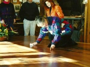 Mira Nakashima polishing the Sacred Peace Table with Miriam Belov in background