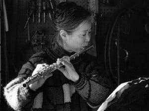 Mira Nakashima played the flute during the ceremony