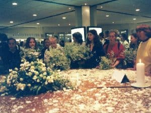 Peace makers gather with flowers and peace messages at the opening of the convention.