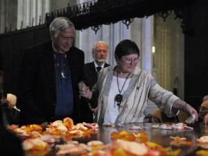 The Very Reverend James Parks Morton and Board Member Irene Etkin Goldman laying flower petals together before offering reflections and reciting Peace Quotes originally gathered by them for the dedication of the Sacred Peace Table in Moscow.