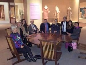 Seated on George Nakashima chairs around his table are (L – R): Mira Nakashima, Miriam Belov, Soomi Amagasu, Kevin Nakashima, John Carpenter, Mme. Ban Soon-Taek, Ru Amagasu, Dr. Nassrin Iromloo Zahedi Mme. Remedios Fe Cabactulan.