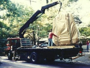 Loading the Sacred Peace Table by crane onto a flat bed truck outside the shop in New Hope, PA.