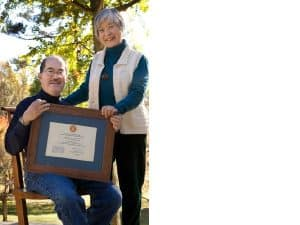 Kevin and Mira Nakashima holding the National Register of Historic Places Plaque, received in August 2008.