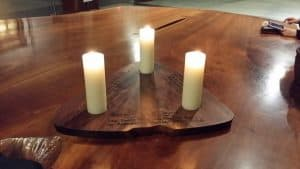 Mira created a special holder for three candles which was inscribed for each venue.
