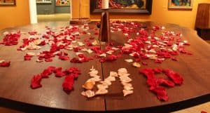 Using the fragrant rose petals that covered the table, the participants spelled out the word Mir, which means Peace in Russian.